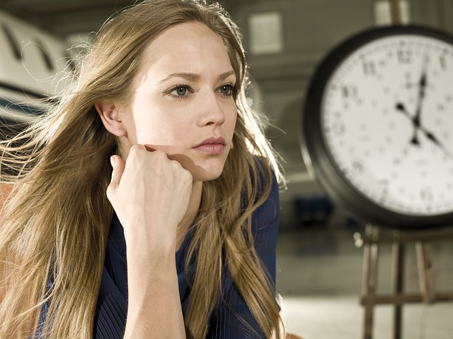 woman and clock