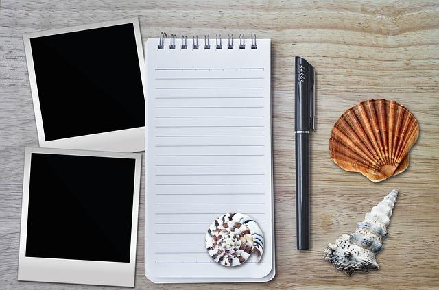 photos notebook and seashells